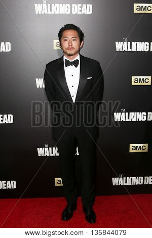 NEW YORK-OCT 9: Actor Steven Yeun attends AMC's 'The Walking Dead' season six premiere at Madison Square Garden on October 9, 2015 in New York City.