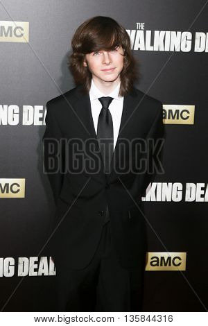NEW YORK-OCT 9: Actor Chandler Riggs attends AMC's 'The Walking Dead' season six premiere at Madison Square Garden on October 9, 2015 in New York City.