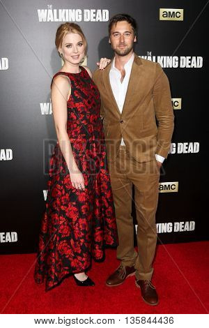 NEW YORK-OCT 9: Actors Alexandra Breckenridge (L) and Ryan Eggold attend AMC's 'The Walking Dead' season six premiere at Madison Square Garden on October 9, 2015 in New York City.