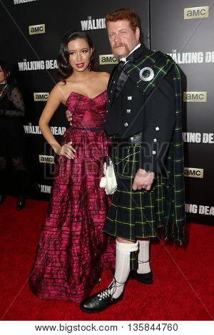 NEW YORK-OCT 9: Actors Christian Serratos (L) and Michael Cudlitz attend AMC's 'The Walking Dead' season six premiere at Madison Square Garden on October 9, 2015 in New York City.