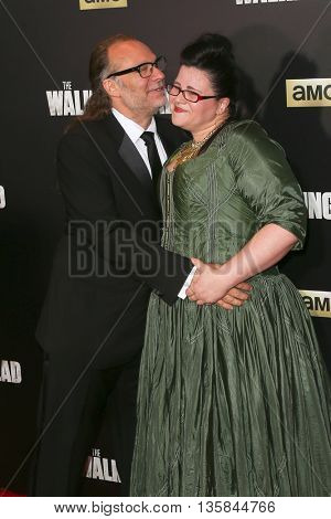 NEW YORK-OCT 9: Greg Nicotero (L) and actress Ann Mahoney attend AMC's 'The Walking Dead' season six premiere at Madison Square Garden on October 9, 2015 in New York City.