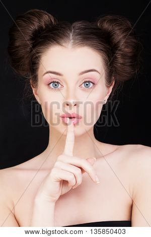 Silent and Shushing. Woman Holding her Finger to her Lips in a Gesture for Silence