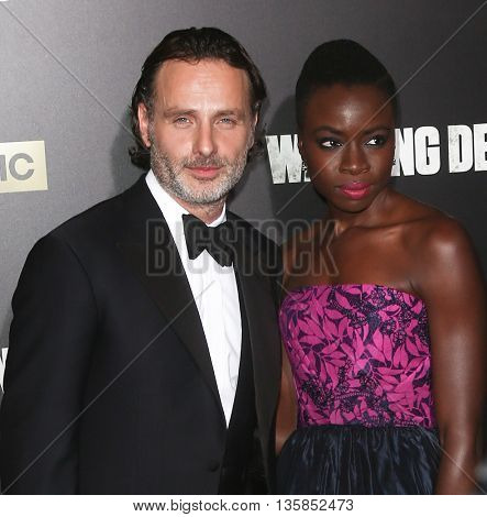 NEW YORK-OCT 9: Actors Andrew Lincoln (L) and Danai Gurira attend AMC's 'The Walking Dead' season six premiere at Madison Square Garden on October 9, 2015 in New York City.