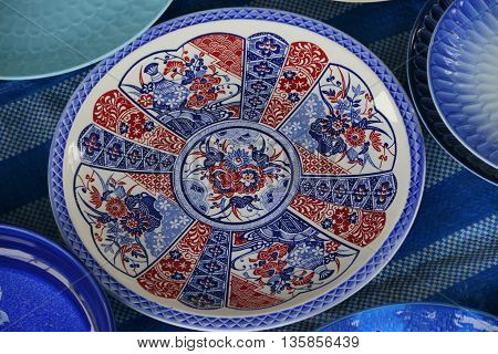 ceramic dinner plate with traditional flower pattern, Songkhla market, Thailand