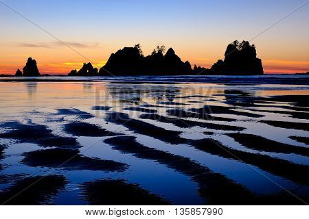 Rocky Coast and Colorful Sunset Reflected in the Tide. Shi Shi Beach, Olympic National Park, Washington