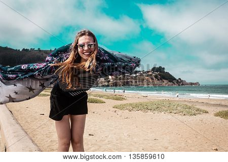 Pretty Girl Walking In Front Of The Beach In California
