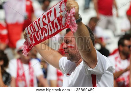MARSEILLE FRANCE - JUNE 21 2016: Polish fan shows his support during the UEFA EURO 2016 game Ukraine v Poland at Stade Velodrome in Marseille. Poland won 1-0