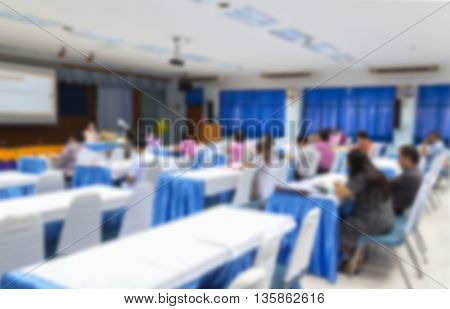 blur blurred abstract Side view at Business education training conference hall or room seminar meeting People Analyzing Statistics Financial Concept with attendee background.