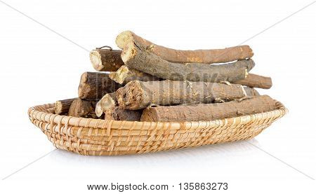 Liquorice roots in basket on white background
