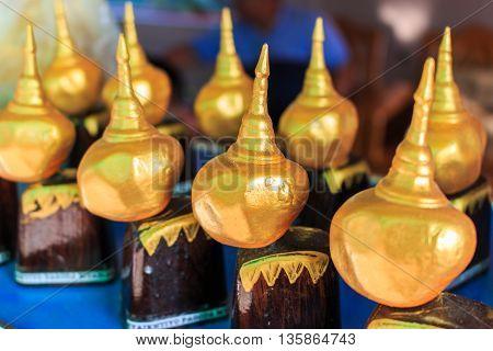 Kyaikhtiyo model souvenir from Myanmar. Golden Rock souvenirs for sale. Kyaiktiyo Myanmar. Tourist souvenirs of the Golden Kyaikhtiyo Rock shrine.
