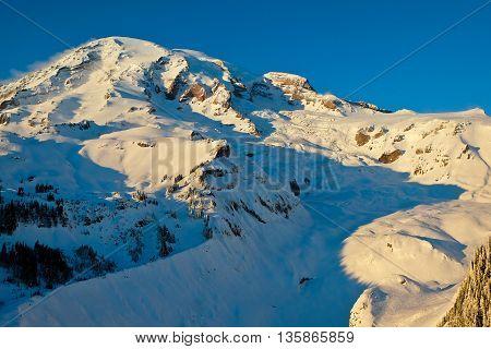 Sunset Illuminates the High and Snowy Peak of Mt Rainier. Nisqually Glacier Vista Mt Rainier National Park Washington