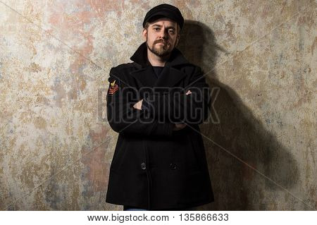 Man Dressed Warmly In A Stylish Black Trench Coat