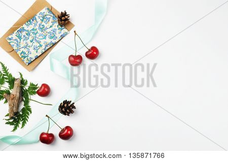 white background table, view table mockup, cherry and envelope