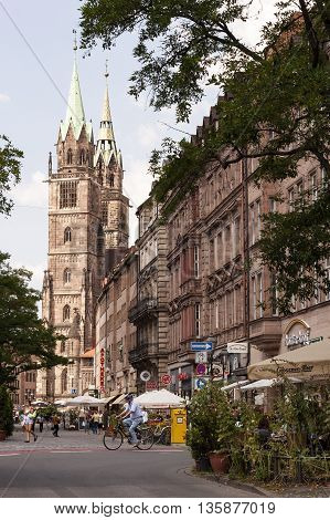 NURNBERG /GERMANY - JULY 17th 2014: Konigstrasse street view with the towers of St Lorenz church at the far end