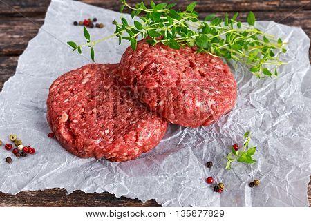 Home HandMade Raw Minced Beef steak burgers on scrumbled paper.