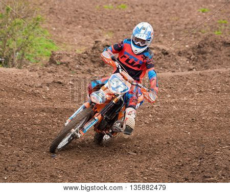 WorcesterUK-April 24 2016 :A competitor taking part in a Motocross race.Motocross is an extreme sport with venues in many countries around the world. This was a free event with no photography restrictions.