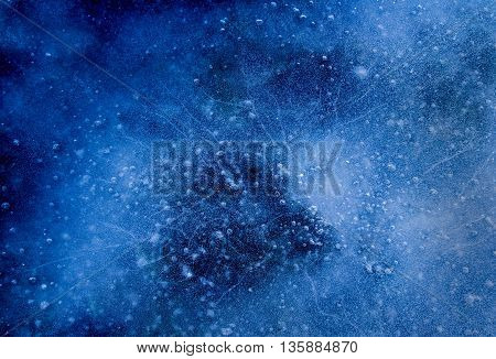 frozen into ice bubbles. Natural background in blue