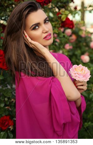 Gorgeous Sensual Woman With Dark Hair With Rose