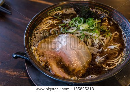 Kuro tonkotsu ramen with chashu pork and bean sprout
