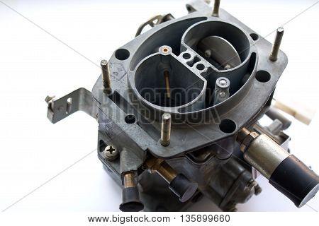 the carburetor on white background, closeup shot