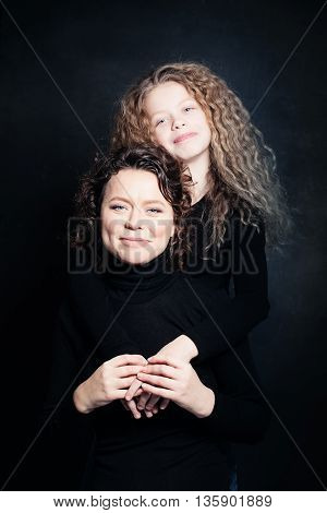 Happy Mother and Child Hugging on black
