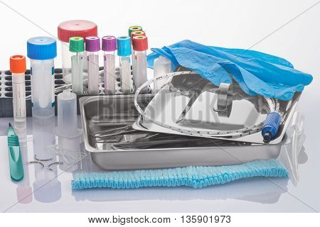 Medical tools in a tray from stainless steel and expendables for clinical laboratory