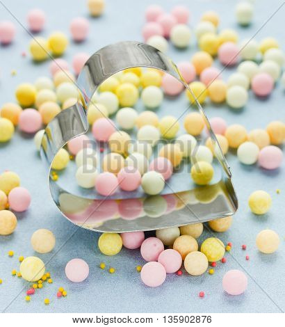 Delicious sweet bubble and cutter heart confectionery background selective focus