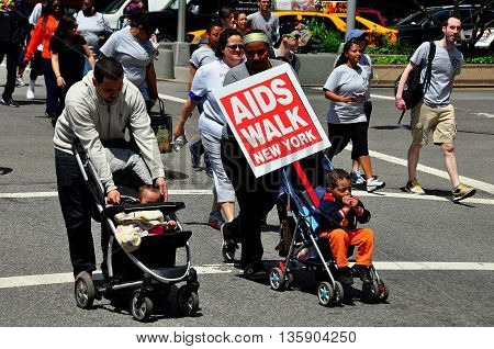 New York City - May 18 2014: Parents marching with their children in strollers at the annual AIDS Walk to raise money for AIDS charities and research  *