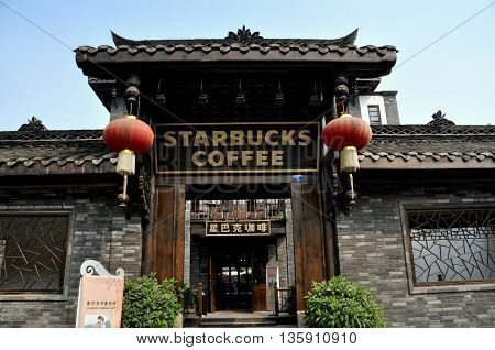 Chengdu China - November 3 2009: Starbucks Coffee emporium in a finely renovated home on Zhai Alley in Old Town