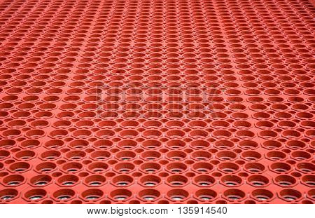 Abstract red perforated plastic background and textured