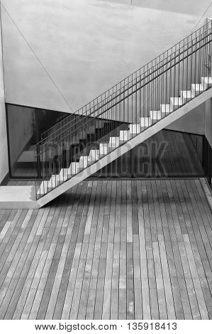 Black and white shot of modern stairs at an office building