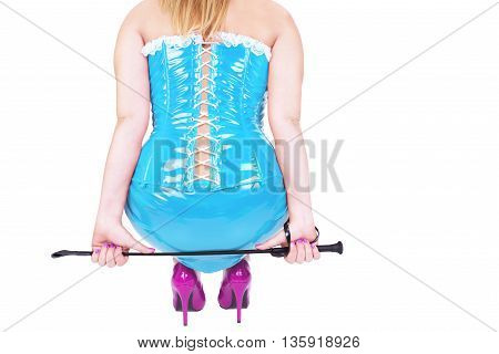 Sexy dominatrix holding riding crop isolated on white background.