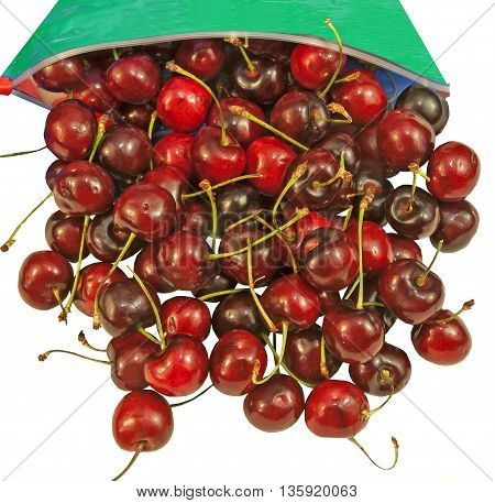 Tasty sweet cherries spilling out of a bag