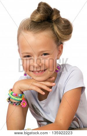 Cute Little Girl With Modern Hairstyle And Lot's Of Loom Bands