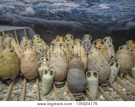 Ancient clay oil bottles or urns from archaeology ruins.