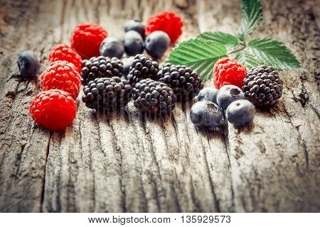 Healthy fruit - seasonal berry fruits on rustic wooden table