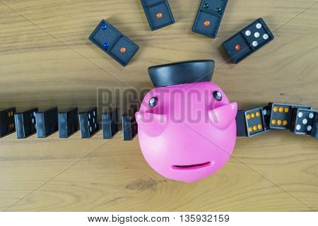 Piggy bank knocking out dominoes strategy and successful intervention