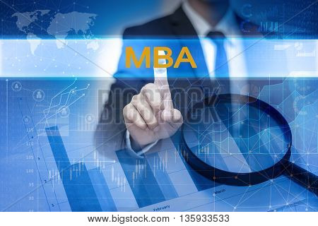 Businessman hand touching MBA button on virtual screen poster