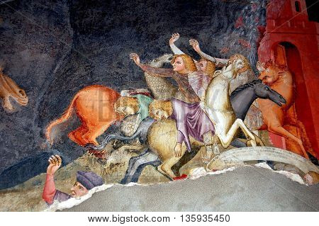 Bolzano Italy - June 2 2006: Painted wall fresco depicting sinners going to Hell covers a wall inside the 14th century Dominican  Catholic Church