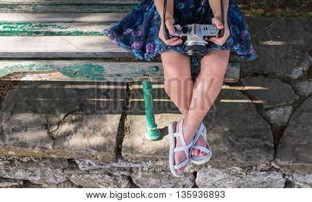 Little Girl Holding Retro Camera