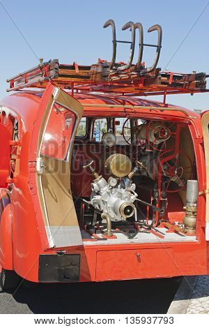 Back of a vintage firemen truck with water pump