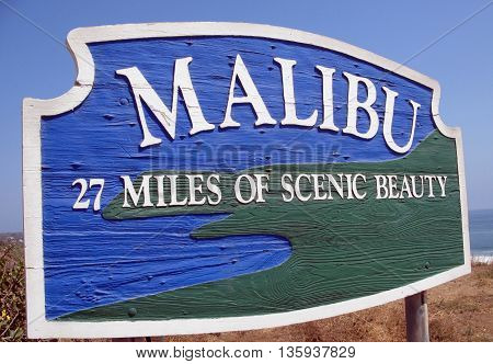 Sign reading Malibu 27 Miles of Scenic Beauty off Pacific Coast Highway near Zuma Beach, California