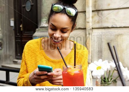 Happy Young African Woman Sitting At Cafe