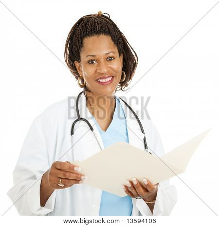 Beautiful african-american female doctor reading a patient's medical chart.  Isolated on white.