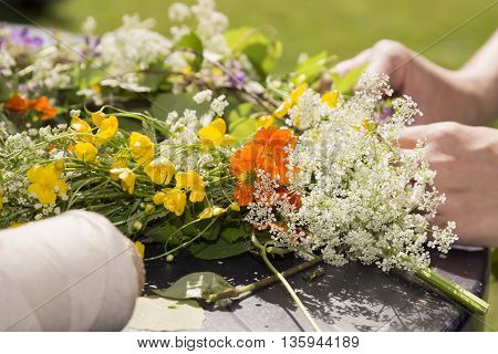 Woman Making a Swedish Midsummer Head Creation.
