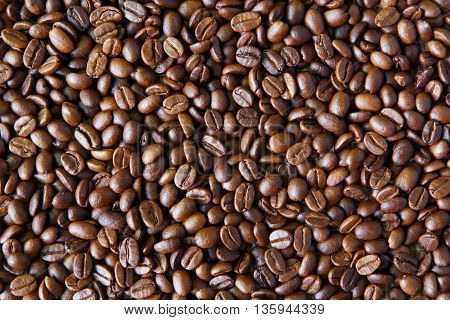 Coffee Beans background, arabika crop texture. Robusta seeds closeup pattern. Top view