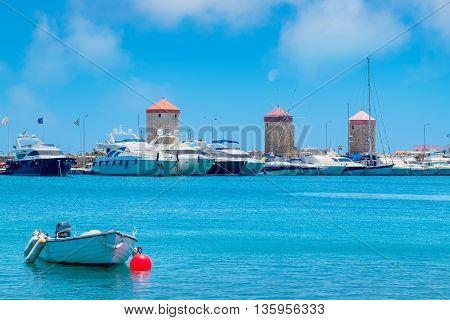 Windmills in Mandraki Harbour. Rhodes Town island of Rhodes Greece Europe