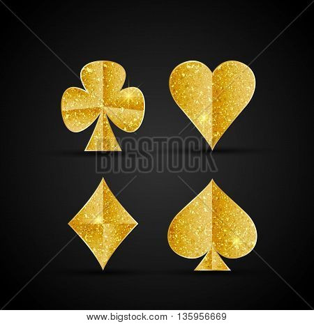 Vector gambling card symbols in gold on a black background