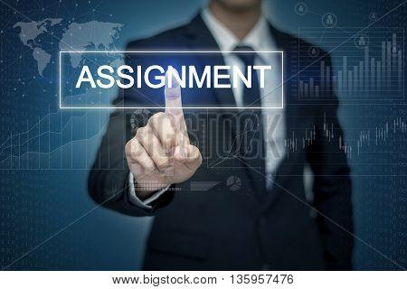 Businessman hand touching ASSIGNMENT button on virtual screen