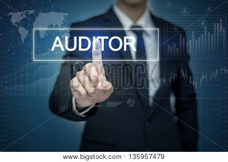 Businessman hand touching AUDITOR button on virtual screen